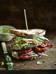 Bread- rocket - chicken - avocado - bread - sundried tomatoes - bacon - onion - mayo (optional, I'd replace it with a very thin layer of pesto) - bread. SANDWICH.