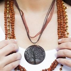 This gorgeous pendant is inspired by the Beringin tree that symbolizes eternal life with its ever-expanding branches. Made with recycled coconut shell and meticulously handcrafted and assembled by artisans.