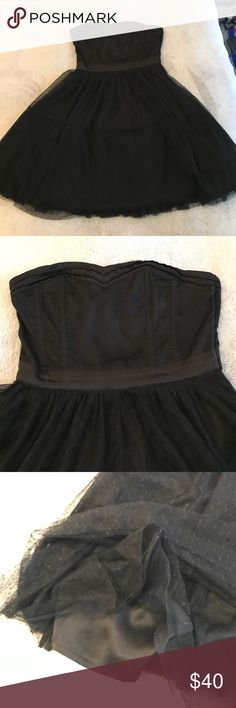 """Divided by H&M Black Polka Dot Tulle Dress Lightly worn Divided by H&M black polka dot tulle dress. Size 4 but runs a tad small—better for someone who's a size 0 or 2. Zip side, hanger straps are available for appropriate storage. 100% polyester. Sweetheart neckline, strapless, four layers of poofy tulle over polyester lining. Boning in chest/back which negates the need for a bra. I'm 5'2"""" and it hits my knees. H&M Dresses Strapless"""