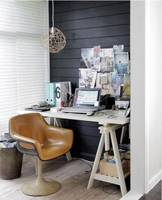 Small on space, big on style, I love everything about this busy little workspace...  (via Art & Design)