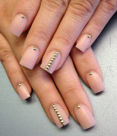 Elegant looking nude nail art with pretty gold beads on top. The beads add to the sheer elegance that the nude polish exudes.