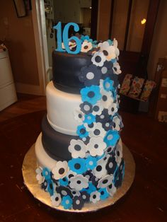 """Sweet 16 Cake. FLowers and """"16"""" are made of gum paste."""