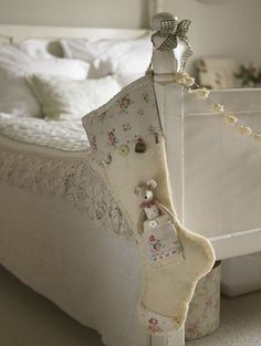 I like the idea of having the Christmas stockings right there on the edge of the bed.