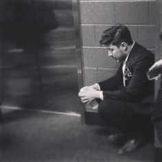 So beautiful.  I don't know when at the Grammys it was taken, but it says so much.  Looks the photographer got him in a pretty vulnerable moment.