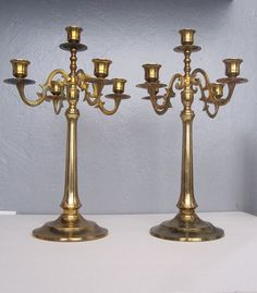 Brass Candleabras, would look cool and creepy for Halloween dining scape....very phantom of the opera