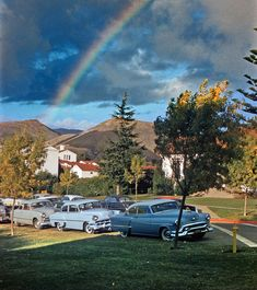 Shorpy Historical Photo Archive :: 1955. A rainbow over the campus of Cal Poly, San Luis Obispo, seems to end on a row of classic 50s cars. 35mm Kodachrome.