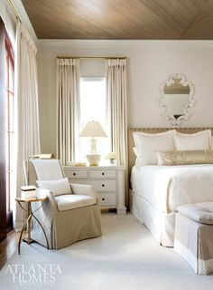 The master bedroom, painted Benjamin Moore's Seapearl, is layered with various shades of ivory and is one of Renee's favorite rooms in the house. The bed was custom designed and features a Cowtan