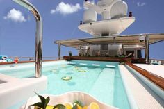 The sun deck of 228-foot Nomad features a Jacuzzi spa pool where you can swim up to the bar, with sunbathing mattresses on each side as well...--AJ MacDonald - Yacht Broker - ajmacdonald@camperandnicholsons.com