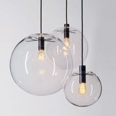Sandra Lindner Selene Lamp    Clear, blown-glass ball. Centrically suspended by a five-armed light head. Insect protection cover and light head in black, powder-coated metal. Bulbs with decorative filament.    Design:  Sandra Lindner    Manufacturer:  ClassiCon