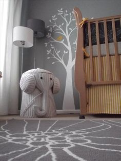 they grey is actually kinda cool... but how about a gray squirrel instead of an elephant?  I like the rug and the tree with the birds.  Maybe have a red bird, too?