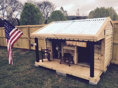 Dog house from left over fencing materials and pallets.