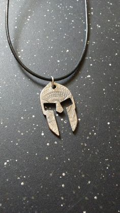 A Spartan helmet hand cut into a half dollar coin using a jewelers saw. Spoon Jewelry, Copper Jewelry, Wire Jewelry, Jewelry Art, Unique Jewelry, Spartan Shield, Spartan Helmet, Coin Crafts, Spray Can Art