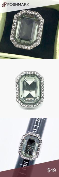 Swarovski Gunmetal Ring w/ HUGE Light Green Stone Swarovski Gunmetal Ring w/ HUGE Light Green Stone in great used condition. Swarovski Jewelry Rings