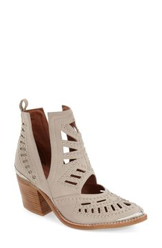 Bold cutout patterns and studs render this Western-inspired ankle boot a statement-making style.