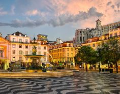 square in Lisbon, Portugal. Rossio square and Santa Justa elevator in Lis ,Rossio square in Lisbon, Portugal. Rossio square and Santa Justa elevator in Lis , Lisbon? It's a little gem! The top spots to visit in one of Europe's most history-rich cities Cheap European Cities, European Travel, Living In Europe, Cities In Europe, Holiday Destinations, Travel Destinations, Travel Tours, Travel Guide, Portugal Holidays