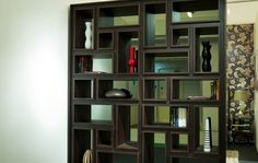 Dark Wenge bookcase with irregular shelving and a mirrored back.