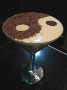 This is my favorite drink - the Yin and Yang from the Melting Pot. This recipe tastes exactly like it. I couldn't find wafers, so I used Hershey's dark chocolate kisses and hugs and flipped them upside down. Or you can make the wafers yourself!