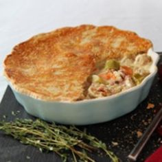 Turkey pie with leeks and carrots. One slice removed to see the creamy filling inside
