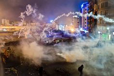 Clouds of black smoke and tear gas wafted over the square on Tuesday night....
