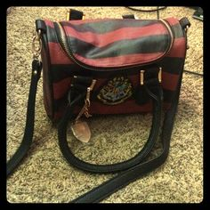 Harry Potter Purse It's a small purse that zips closed. It has a small zipper compartment and two pockets insides. Comes with long strap. Brand new without tags! Never used! Bags Mini Bags