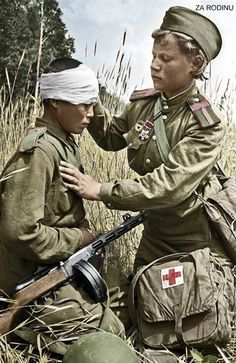 Wounded Russian, child soldier, is patched up by a child medic in the field...