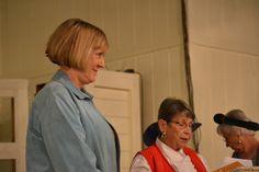 Debbie Billa, WellMed Foundation, waits to address audience.