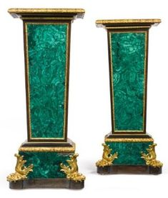 A pair of Louis XIV style ormolu-mounted malachite and ebonized pedestals probably Russian, second half 19th century.