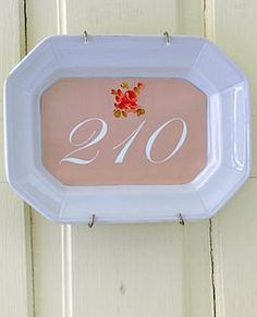 Painted house numbers on an old platter