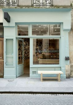 Muted teal/mint store front