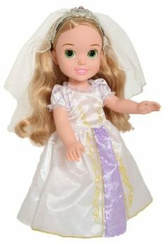 """Disney Princess Rapunzel's Wedding Dress Up by Disney Princess. $21.05. Share the magic and romance of Rapunzel's wedding day. Use the included brush to style Rapunzel's shimmering hair before she walks down the aisle. Beautiful 15"""" doll wears a gorgeous gown, ravishing royal tiara, and special wedding day shoes. From the Manufacturer                It's the big day for Rapunzel and Flynn. Share the magic and romance of Rapunzel's wedding day with this gor..."""