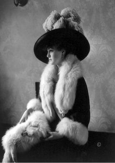 Amazing hat / feathers / fur. Wow. 1911 photo of Louise Cromwell Brooks (1890-1965), an American socialite considered to be Washington's most beautiful young women. She is shown here in 1911 at the age of 21 wearing a most fashionable ensemble. She was married to General Douglas MacArthur from 1922-1929.