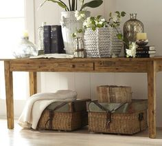 I'm looking for accessory ideas for our entryway piece and our coffee table. Like the round vases.
