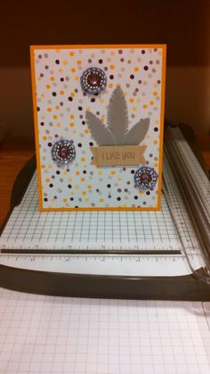 This was made using Stampin' Up! Moonlight DSP, a Lawn Fawn stamp I got for free with my order, Jenni Bowlin feather rub-ons, and Prima Flower Centers!