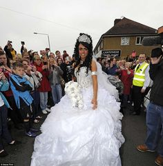 Mobbed: Fans of the Channel Four television show My Big Fat Gypsy Wedding swarm around Danielle as she gets out of her limousine at the chur...