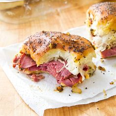 Pastrami and Swiss Football Sandwiches: Brushed with a butter sauce and baked, these hot sandwiches are a game-day favorite.