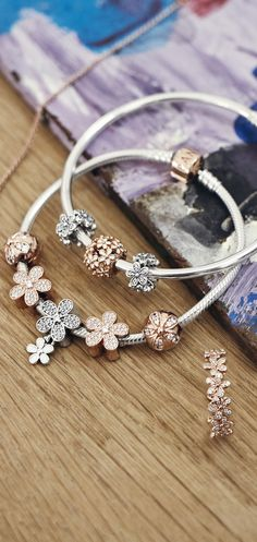 A fresh take on rose-coloured metals: finely detailed daisy charms and rings, made to match your spring mood and your favourite sterling silver pieces.