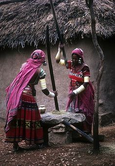 India | Banjara women pounding grain near Hyderabad.  Andra Pradesh | © John Isaac