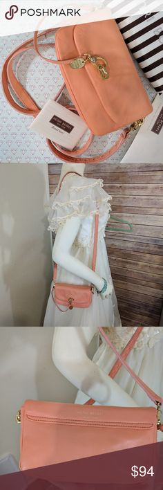 """Henri Bendel Sutton Mini Bag Light Orange DETAILS STYLE NUMBER: 26512139830193 100% Soft cow hide Turn key closure Custom Henri Bendel hardware Satin lining Dimensions: 4""""H X 7.5""""W X 1.75""""D; 22"""" Crossbody drop  Can be worn as a classic crossbody with the adjustable strap or as an over-the-shoulder statement bag.   This bag is like new only worn once or twice. It's just a bit too small for my taste. Still have the tags. The leather has some very slight wrinkling due to being in storage…"""