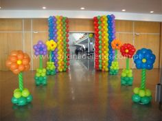 Flower Balloon Decorations..Love the Balloon walls in back!