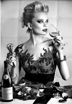 She looks gorgeous! I want that dress and makeup and all! And the wine. I am really craving some wine......