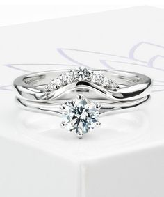 The Tiara diamond wedding ring. Featuring a graduating set of round brilliant cut diamonds. Designed to add sparkle to an existing solitaire engagement ring, perfectly shaped to fit around most settings.