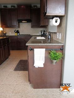 use a rail on the side of your cabinets! Add pans on hooks, towels, herbs in pots! I love this idea!