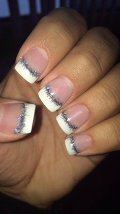 Gel nails with a French tip and sparkle smile line!