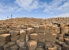 Photo by @jeffmauritzen. Visitors to the Giant's Causeway navigate the nearly 40000 hexagonal basalt columns that jut into the sea. This #UNESCO world heritage site is well worth a visit next time you find yourself in Northern Ireland. Insider tip: stay for sunset. Most organized bus tours will leave beforehand so think about driving yourself to this destination. #giantscauseway #northernireland by natgeotravel