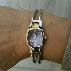 """Fossil  Watch 2 Tone Mostly  silver tone  with a bit of yellow. Blue face. Bangle  like . Fite adv. 7"""" wrist. fossil  Jewelry"""