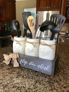 This is the perfect way to display your kitchen utensils in a charming, fun way! These make perfect housewarming gifts, and Im happy to giftwrap as well! I can do any color jars or box, and can customize the writing as well. This piece includes the 3 cream wide mouth quart jars and the bar wood gray box. Both can be customized to your liking! This box is 12.5 inches long, 5.5 inches wide, and stands to be 8 inches tall in the box. If you would like to change the colors of the jars just leave…