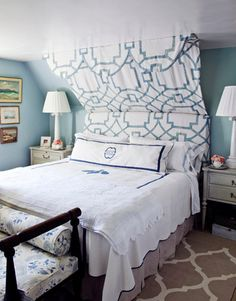 Master bedroom at Bee Cottage.  Excellent way to show off dormer ceilings.  (via House Beautiful)