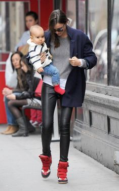 Miranda Kerr and her lil' one in Marant wedge sneakers and leather leggings, LOVE!!!!