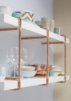 Transform your shelving in to a real feature by adding trend setting copper piping for a slightly industrial, yet chic look.
