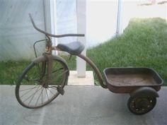 My younger sister and I had a green and white tricycle with wagon. It was old when we got it but not quite this old. We rode it all around the neighborhood.